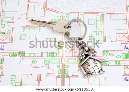 House keyring on architectural home plan - stock photo