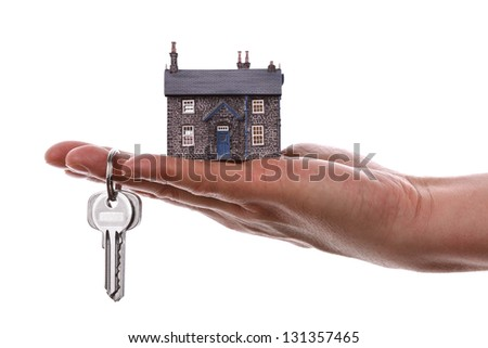 House keys and model house concept for selling or moving home - stock photo