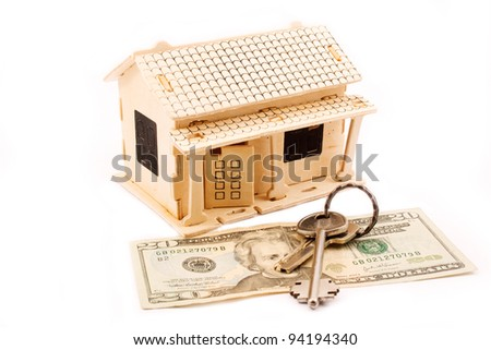 House keys hanging on the chimney of a House - stock photo