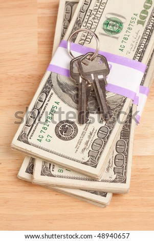 House Keys on Stack of Money - Cash for Keys Program. - stock photo