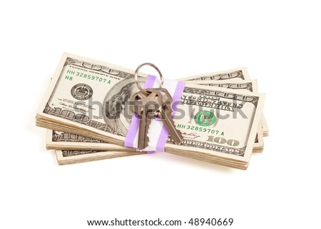 House Keys on Stack of Money Isolated on a White Background - Cash for Keys Program. - stock photo