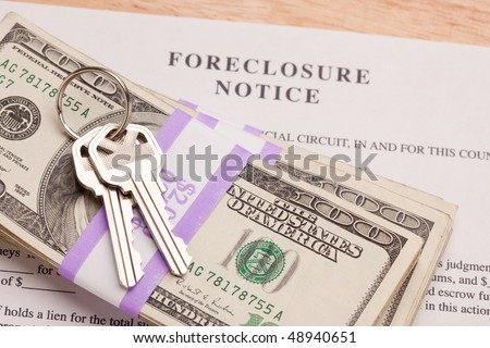 House Keys, Stack of Money and Foreclosure Notice - Cash for Keys Program. - stock photo