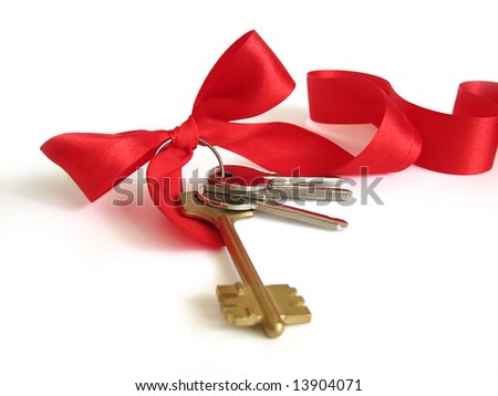 House keys with red bow from ribbon - stock photo