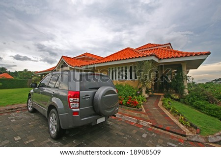 house lawn and vehicle - stock photo