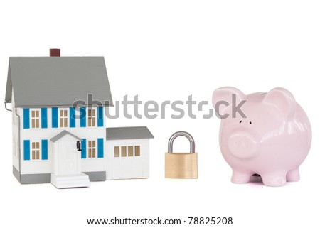 House locked with padlock and pink piggy bank against a white background