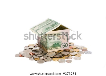 House made from banknotes on the pile of coins - stock photo