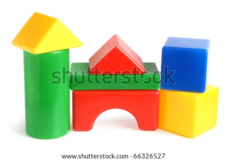 House made from children's plastic building blocks on a white background - stock photo