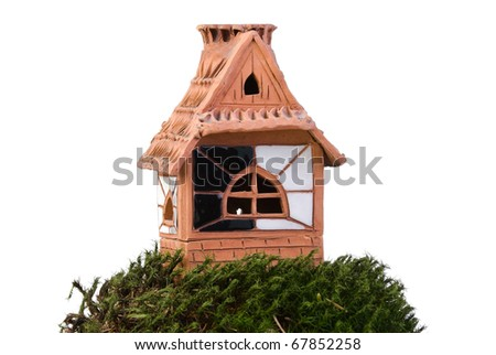 House made from clay on moss over white - stock photo