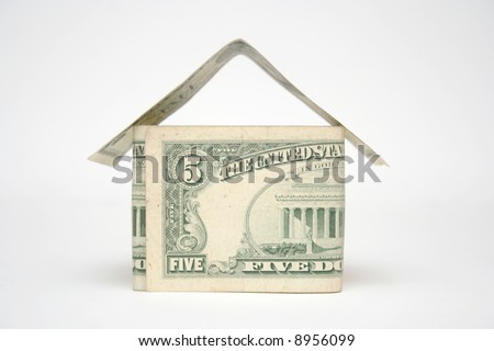 House made from dollar bills on light background