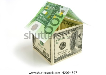 House made from dollor  and euro  bills on white  background