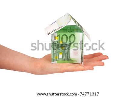 House made from euro bills in female's hand - stock photo