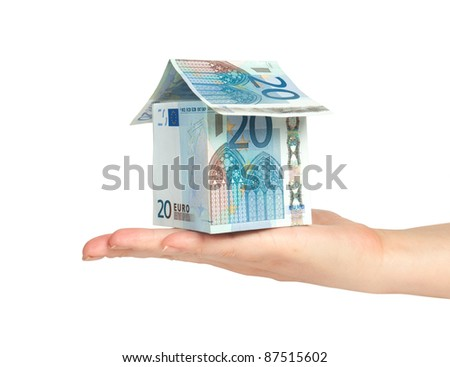 house made from euro bills in  hand - stock photo