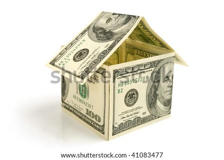 House made from hundred dollor  bills on white  background - stock photo