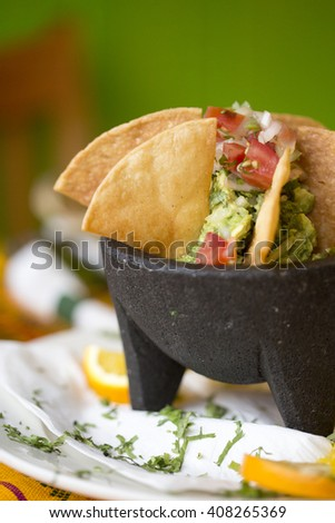 House made guacamole with tortilla chips  - stock photo