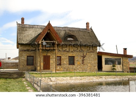 House made in old Moldavian style with thatched roof - stock photo