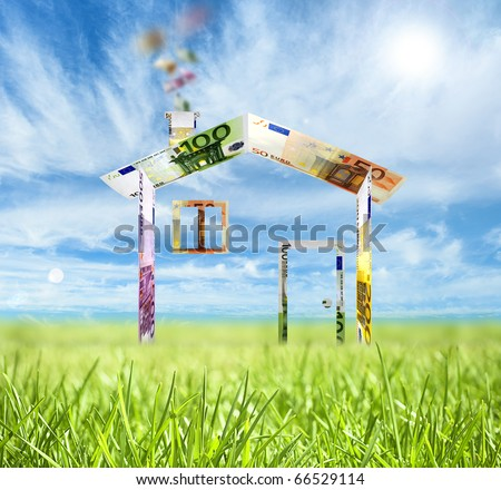 House made of bank notes in the green field - stock photo