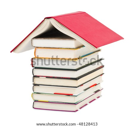 House made of books isolated on white background - stock photo