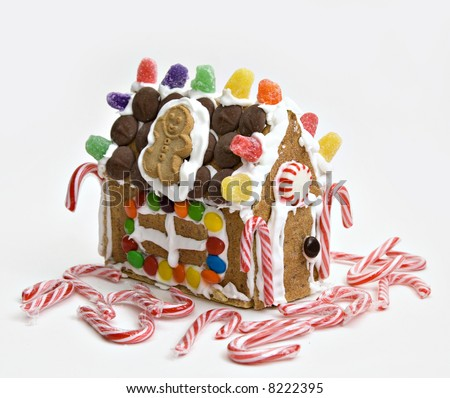 House made of confections, crackers, cookies, candies and royal icing.