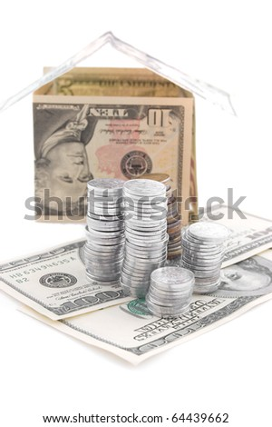 House made of dollars with silver coins on white