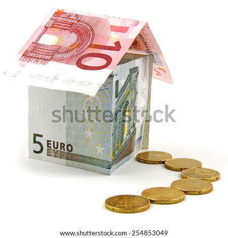 House made of Euro biljets over white background