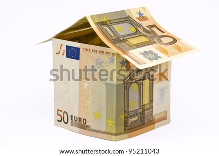 house made of euro money bills isolated on white background - stock photo