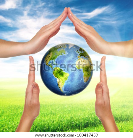 house made of female hands with planet earth globe inside - stock photo