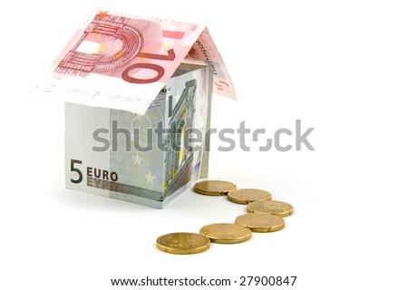 House made of money, isolated on white background - stock photo
