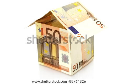 House made of money on a white background - stock photo
