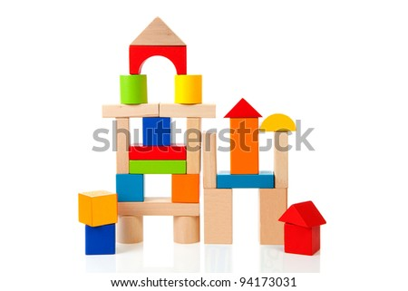 House made out of colorful wooden building blocks over white background