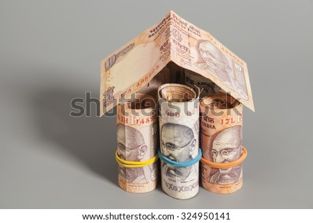 House Made Roll of Indian rupee banknotes isolated on gray - stock photo