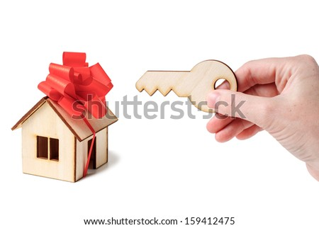 House Model  and hand with key   isolated on white background.