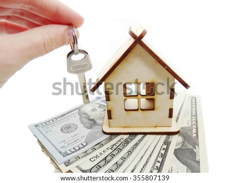 house model dollar cash money key in hand real estate concept                                - stock photo
