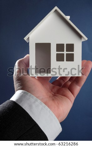 House model in hand. Real property or insurance concept - stock photo