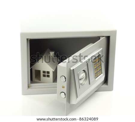 House model in safe box. Real property or insurance concept - stock photo