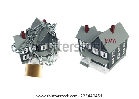 House model plastic with chain and padlock for security concept - stock photo