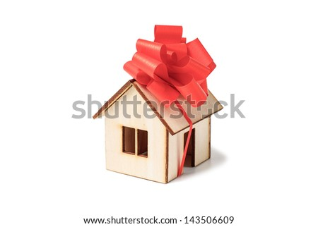 House model with red bow - isolated on white background.