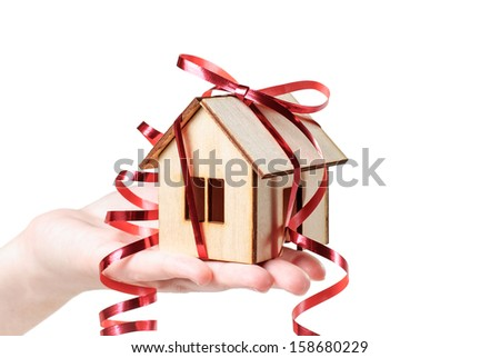 House model with ribbon on  hand  isolated on white background