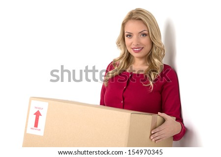 House moving. Cheerful middle-aged woman holding cardboard box and smiling  - stock photo