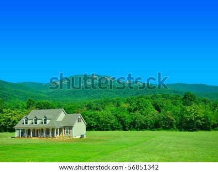 House near a nice green Hill - stock photo