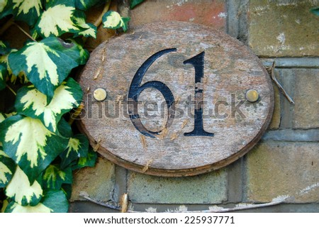 house number 61 - stock photo