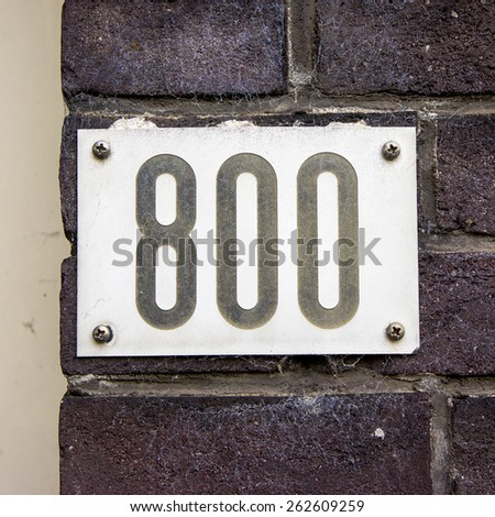 house number eight hundred. Black numerals on a white background - stock photo