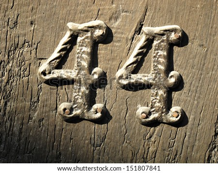 House number,forty-four - stock photo