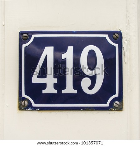 house number four hundred nineteen on an enameled plate - stock photo