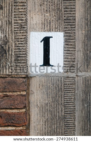 House number of Binnenhof 1 in The Hague. This is the address where The Council of State is established. - stock photo