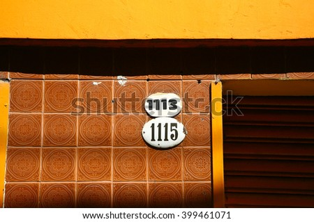 House number on a door - stock photo