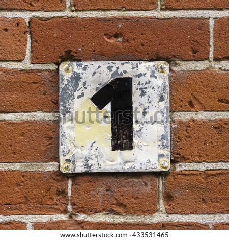 House number one, hand painted on a metal plate - stock photo
