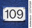 House number one hundred and nine engraved in a formica plate. - stock photo
