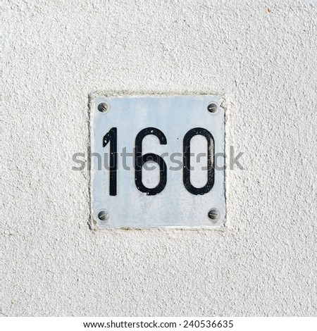 house number one hundred and sixty, engraved in an aluminum plate - stock photo