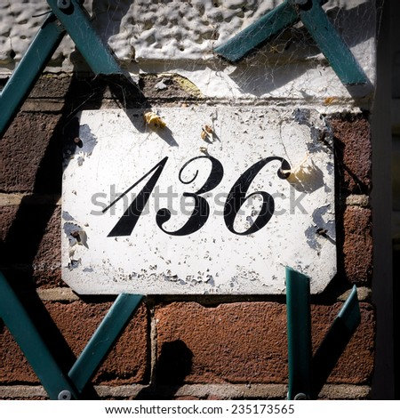 house number one hundred and thirty six - stock photo