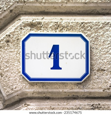 House number one on a ceramic tile. Blue numeral on a white background - stock photo